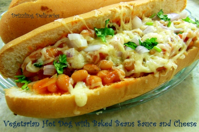 Vegetarian Hot Dogs smothered in cheese and Baked Beans Sauce