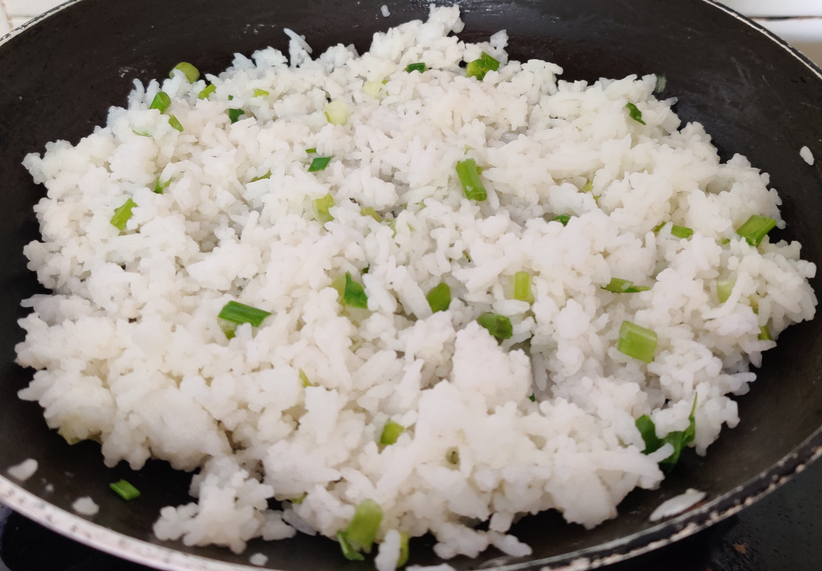 buttered rice with spring onion greens