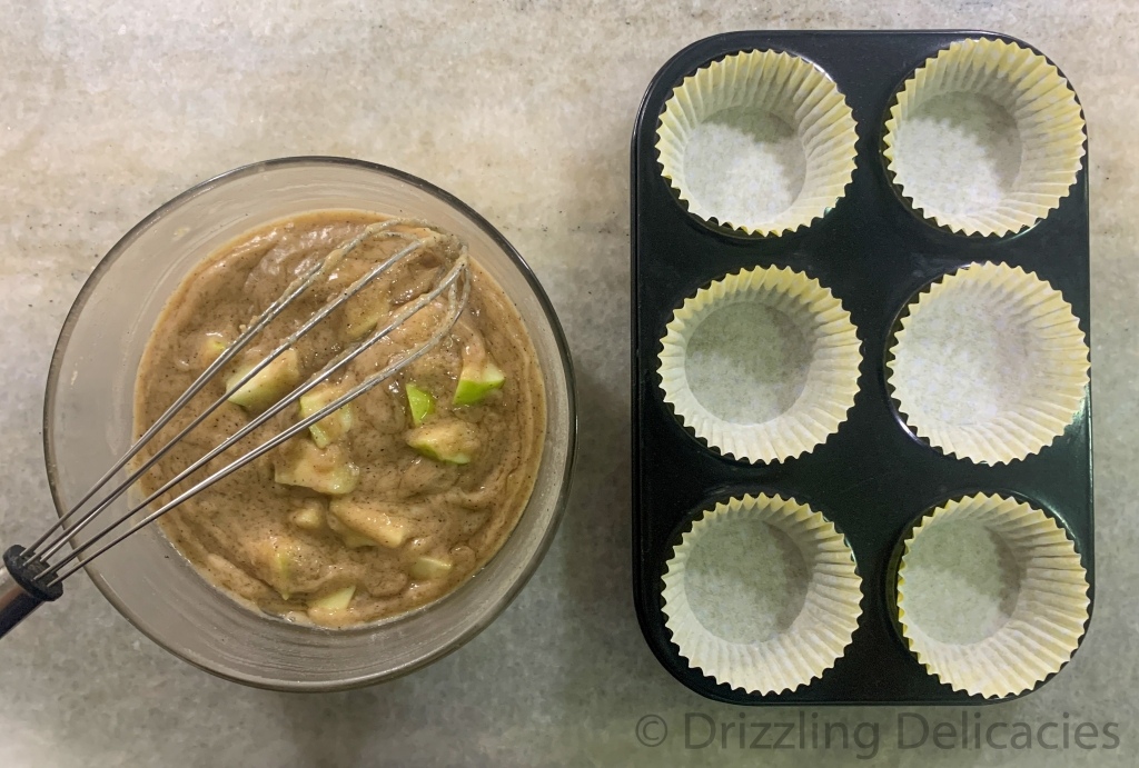 green apple muffin batter with muffin tray