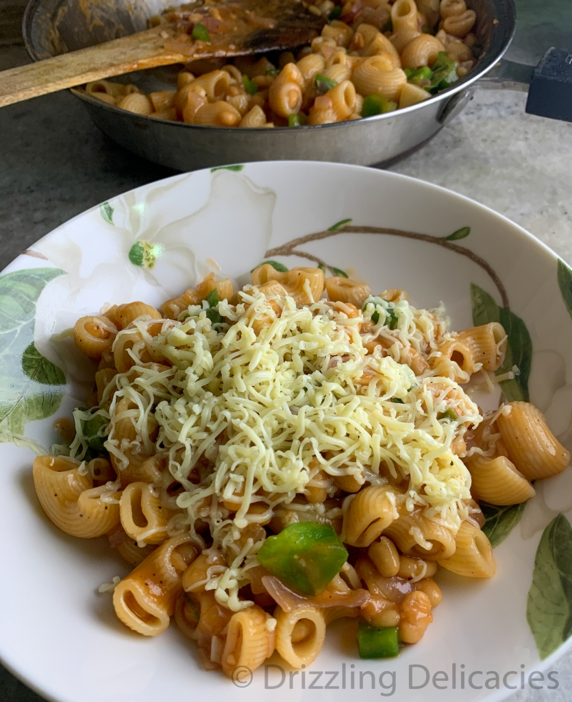 Grated cheese with pasta in baked beans sauce