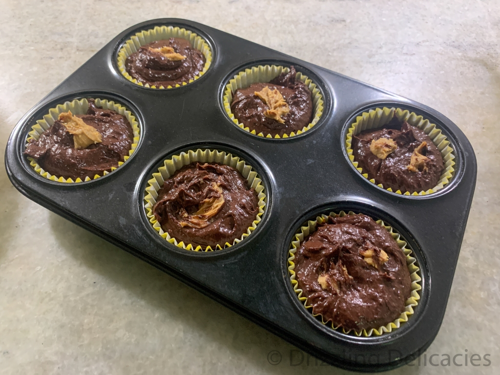 chocolate peanut butter muffin batter in muffin tray